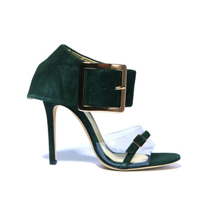 Profile of Neeka green suede heel with clear strap across foot with large buckle enclosed ankle wrap