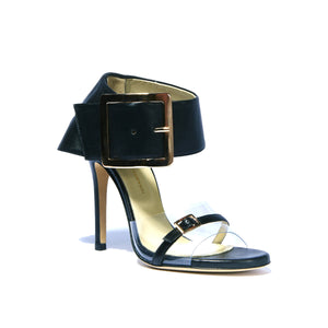 Open toe Neeka black leather heel with clear strap along toes with large buckle enclosed ankle wrap
