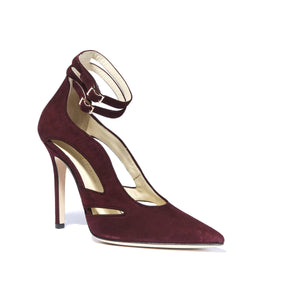 Nicole bacco suede heel with cut outs along the side of the foot and ankle straps with a pointed toe
