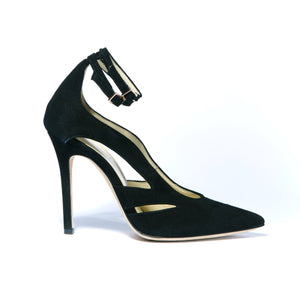 Profile of Nicole black suede heel with cut outs along the side of the foot and two ankle straps