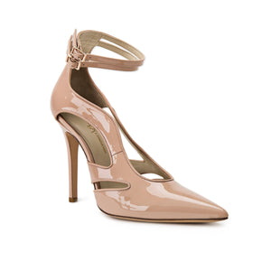 Nicole nude patent heel with cut outs along the side of the foot and ankle straps with a pointed toe