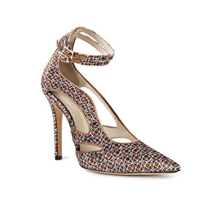 Nicole patterned velvet heel with cut outs along the side and two ankle straps with a pointed toe