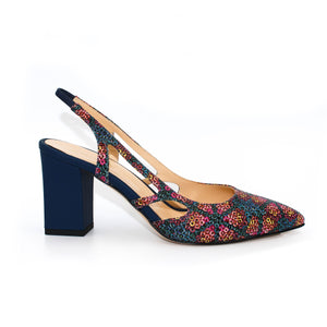 Profile view of Ravello block heel slingback in floral patterned Italian leather with navy blue heel