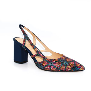 Three quarter view of Ravello block heel slingback in patterned Italian leather with navy blue heel