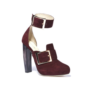 Ronnie bacco suede boot with a horn heel and platform accented with large buckles on ankle and foot