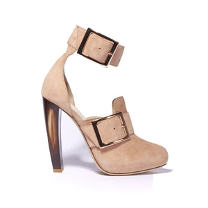 Profile of Ronnie tan suede boot with a horn heel and large buckle accents around ankle and foot