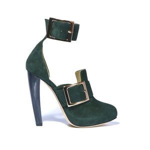 Profile of Ronnie green suede boot with a horn heel and large buckle accents around ankle and foot