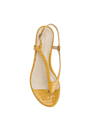Top view Sofia yellow crocco patent leather flat sandal with thong ankle strap and nude sole