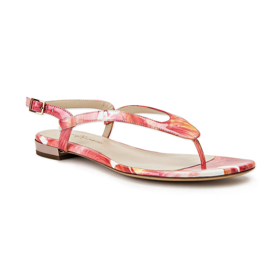 Profile of Sofia dante floral patent leather flat sandal with buckle enclosure ankle strap