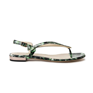 Profile of Sofia green leaf patent leather flat sandal with buckle enclosure ankle strap