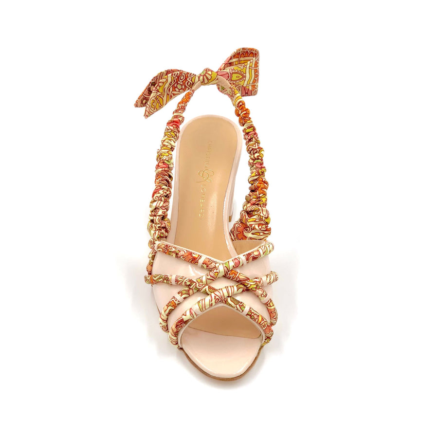 Profile of nude Valentina block heel sling back sandal with pink & orange patterned silk accents