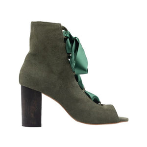 Profile of Cortina birch colored, suede, lace up boot with a complimentary wooden block heel