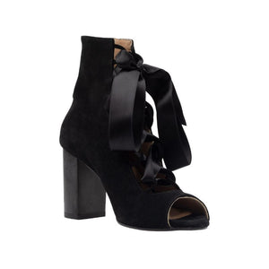 Left angel of Cortina black, suede, lace up boot with complimentary satin ribbon