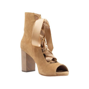 Left angel of Cortina lion colored, suede, lace up boot with complimentary satin ribbon