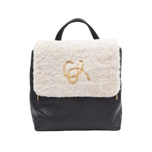 Front of sherling black leather Santa Monica backpack. White fur close flap and gold hardware logo