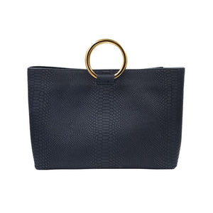 Front view of Wilshire Navy Kobra embossed leather handbag with gold circular handles