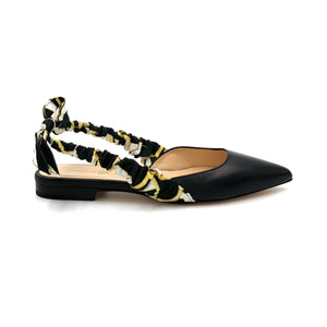 Profile of Paloma black nappa leather flat with patterned silk wrapped sling back and pointed toe