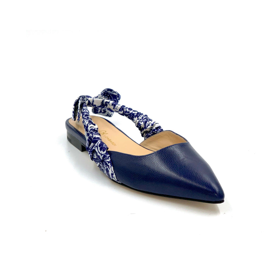 Profile of Paloma navy caviar leather flat with navy paisley silk wrapped sling back and pointed toe