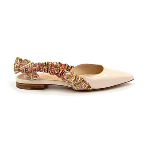 Profile of Paloma nude patent leather flat with patterned silk wrapped sling back and pointed toe