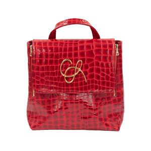 Front of Red Patent leather Santa Monica backpack with a magnetic close flap and gold hardware logo