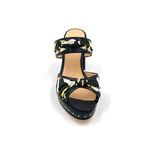 Front view of black Serena block heel sandal with black yellow and white patterned silk accents
