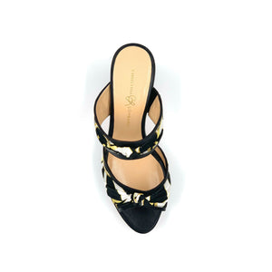 Top view of black Serena block heel sandal with black yellow and white patterned silk accents