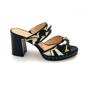 Profile of black Serena block heel sandal with black yellow and white patterned silk accents