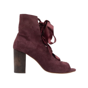 Profile of Cortina wine colored, suede, lace up boot with a complimentary wooden block heel