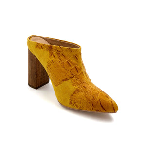 Left angle of Zermatt yellow patterned leather wrapped mule with a chunky wooden heel
