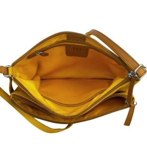 Yellowstone Leather crossbody with adjustable shoulder strap. Two top zip and one open compartments, back zip pocket. Interior- zip and slide pockets. Dimension: 9.75 x 7 x 1.5 in.