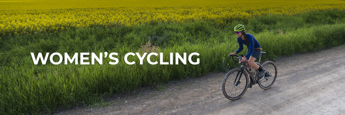 Swiftwick Women's Cycling Header Image, Woman cycling by field