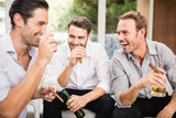 Guys enjoying a cigar and a drink