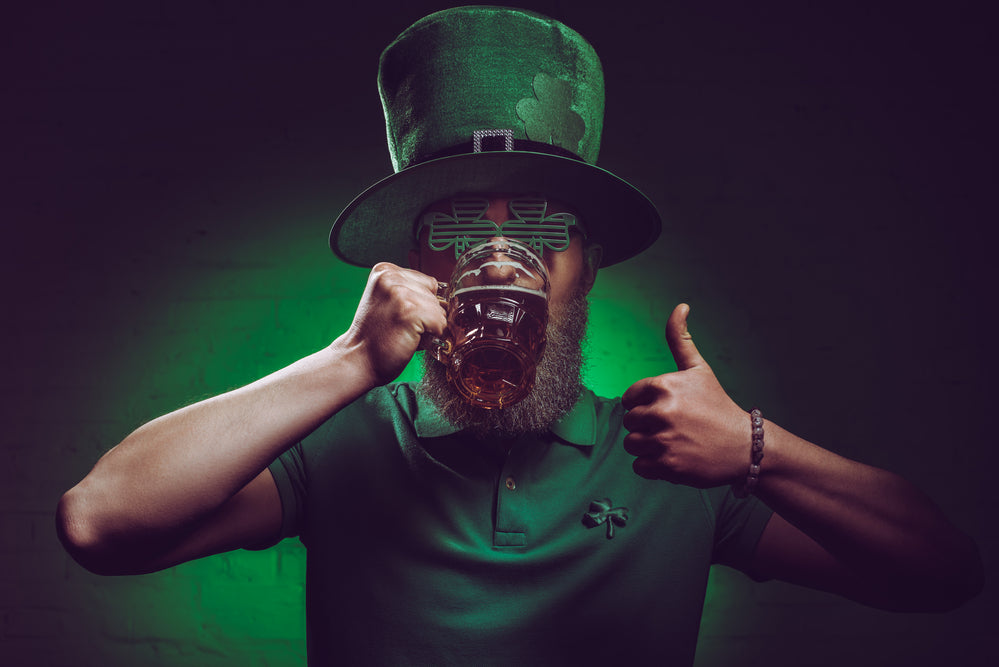 Man dressed for St Patricks Day and enjoying a red irish ale