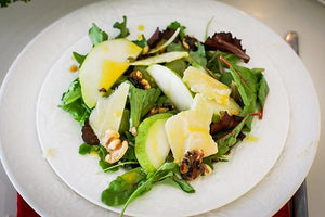 Pear Salad with Dried Cherry Vinaigrette and Macadamia Nut Medallions
