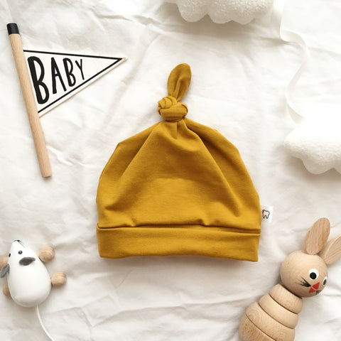 Mustard Jersey Baby Knot Hat