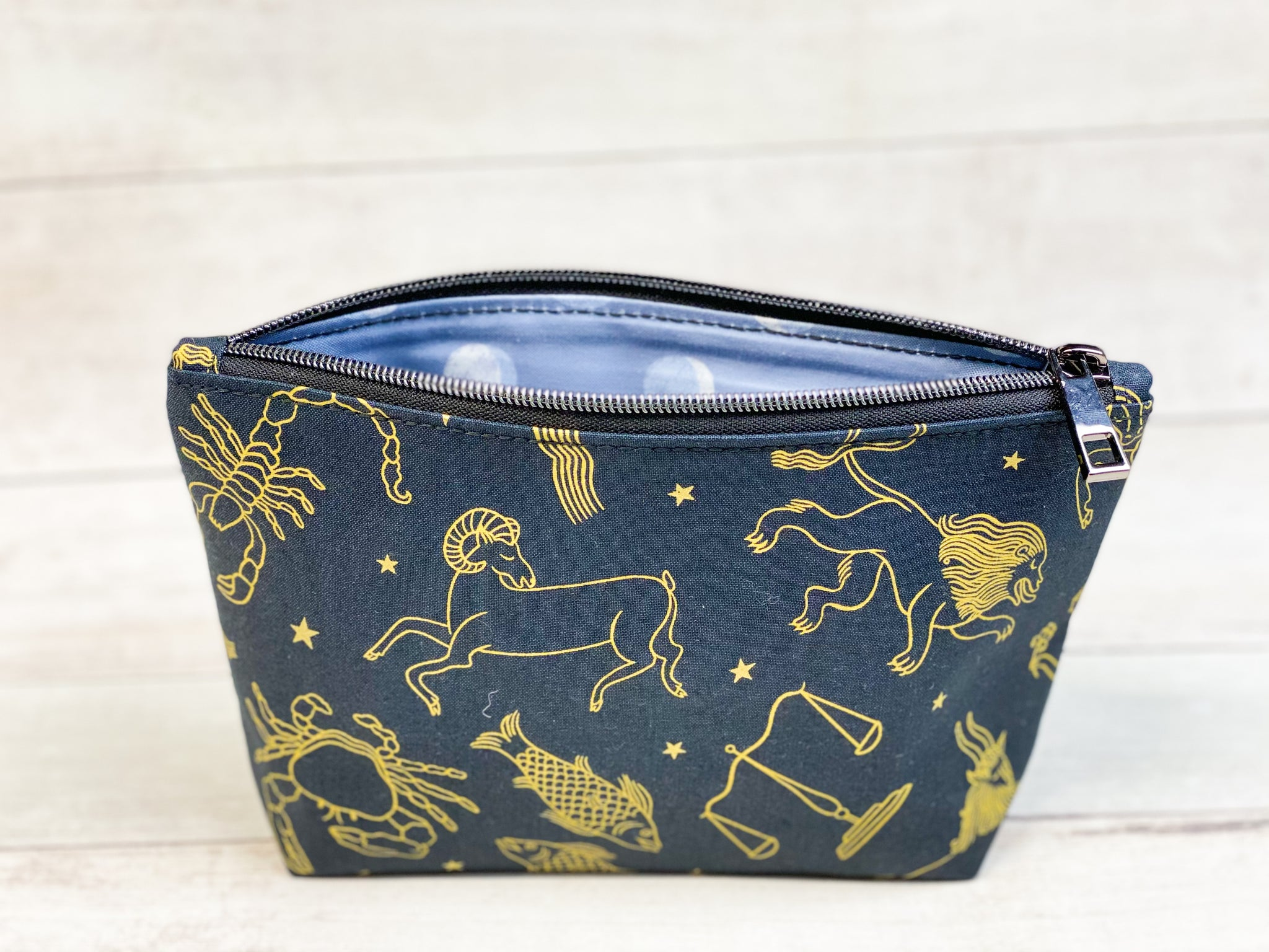 black and gold zippered pouch
