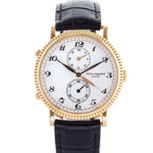 Patek Philippe Travel Time 18K Yellow Gold Ref. 5034J - Twain Time, Inc.