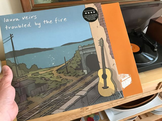 'Troubled By The Fire' LP Out Now, New Album in The Works, 'July Flame' Makes Best List