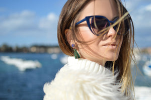 women wearing sunglasses and earrings on a boat