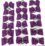 purple tailless bow with rhinestones