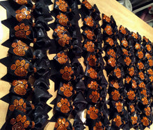 Load image into Gallery viewer, Black cheerleading bow orange rhinestone paw