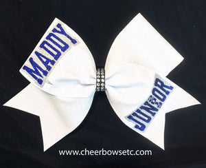 white rhinestone glitter cheerleading hair bow with royal blue glitter lettering
