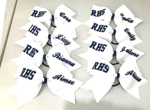 white grosgrain cheer bow with navy blue and silver team lettering