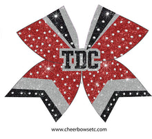 Load image into Gallery viewer, Black & silver 3D Center on a red cheerleading hair bow