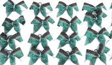 Load image into Gallery viewer, Teal and black cheerleading bow with crystal rhinestones, competition cheerleading bow, rhinestone bow