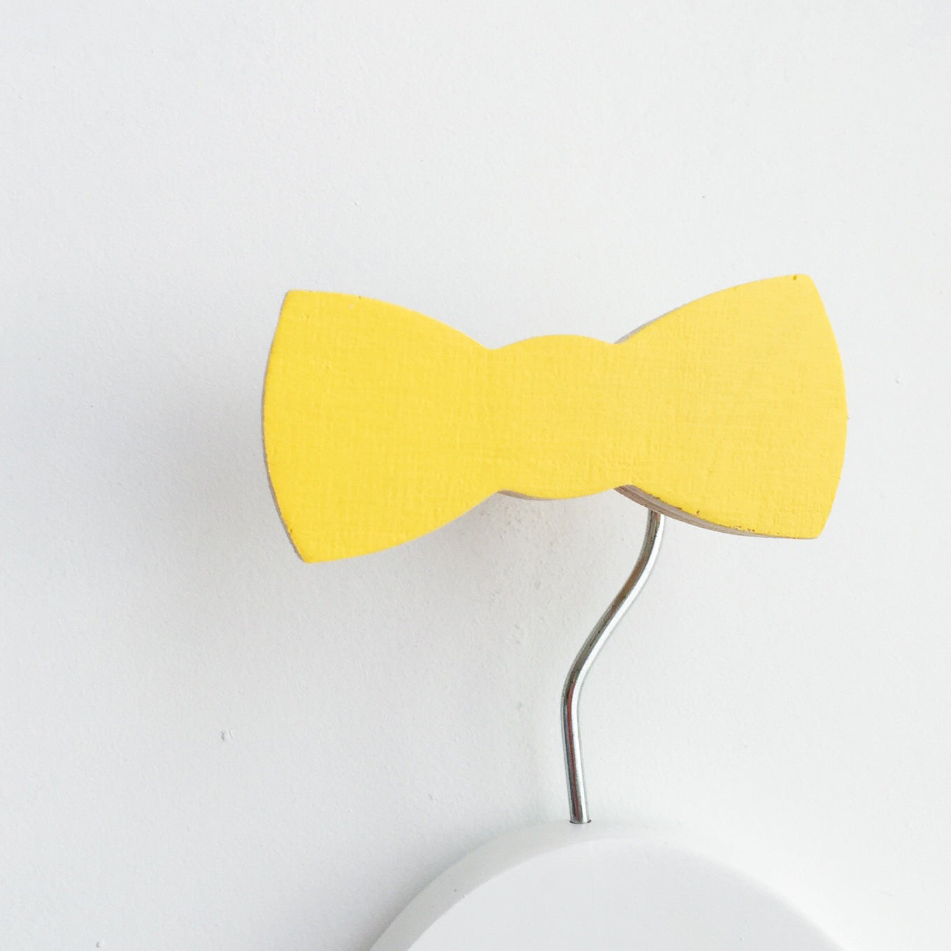 knobbly. bow tie wall hook yellow