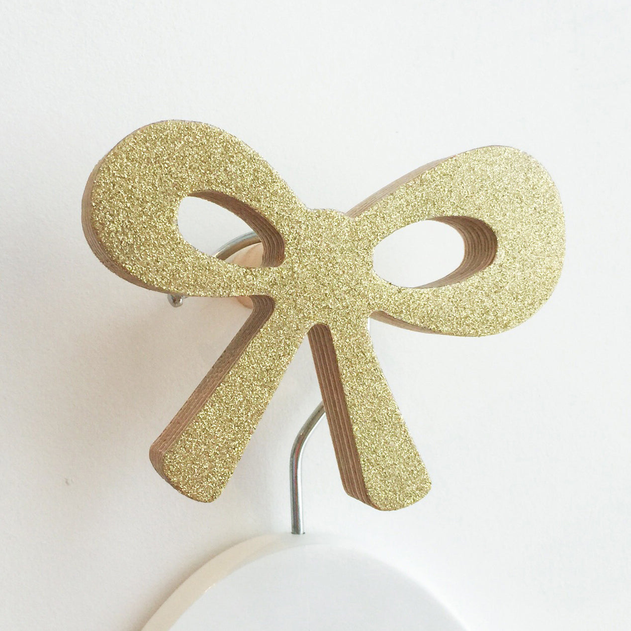 knobbly. ribbon bow wall hook gold glitter