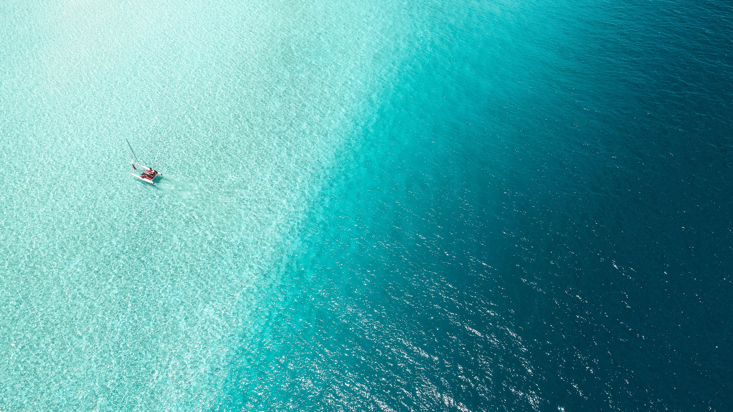 A boat in the blue ocean