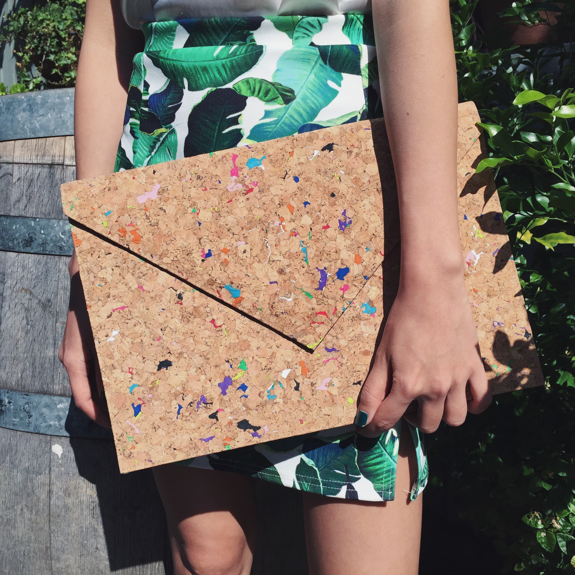 Woman holding By The Sea Collection, Alice, colourful vegan cork leather document case