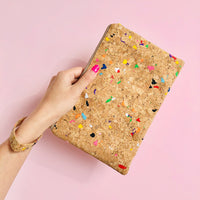 Woman using wristlet of By The Sea Collection, Annie, colourful vegan cork leather pouch